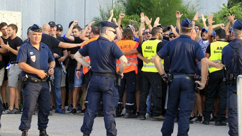 Riot police injured in football clash