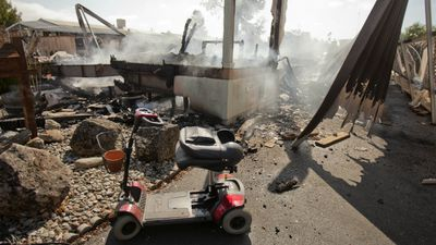 An abandoned electric scooter sits in front of one of the four mobile homes that were destroyed by a fire at the Napa Valley mobile home park after a 6.0 magnitude earthquake hit the San Francisco Bay Area, in Napa, California, USA, 24 August 2014. (AAP)