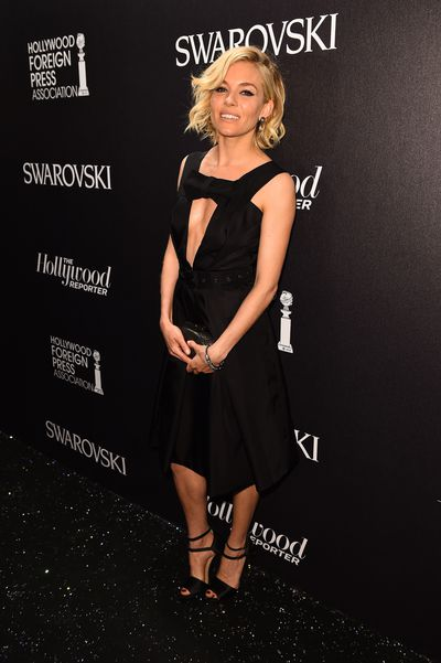 <p>For the Hollywood Reporter and Swarovski party, Sienna opted for a key-hole Prada dress from the Pre-Fall 2015 collection. </p>
