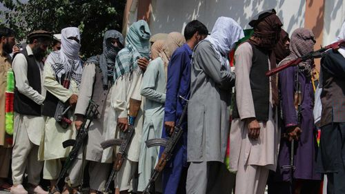Taliban militants and Islamic State fighters are seen in a surrender ceremony in Kunar province, Afghanistan.
