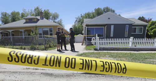 Police officers stand in front of the home, right, of Ayoola A. Ajayi  (AP Photo/Rick Bowmer)