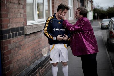 Elton John SO wishes the real him could do this to the real Becks!