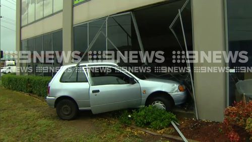 The silver Toyota Starlet has smashed through the windows of a carpet store in Clyde. (9NEWS)