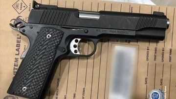 A 9mm pistol seized from the second search warrant executed on a unit in Lidcombe.