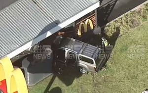 Elderly man hospitalised after car crashes at McDonald's Clayton South in Melbourne