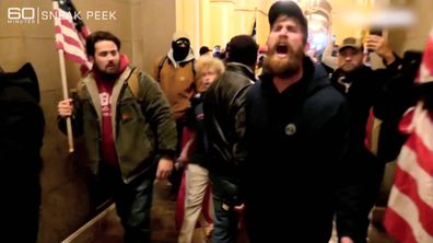 A frenzied mob storms the US Capitol building.