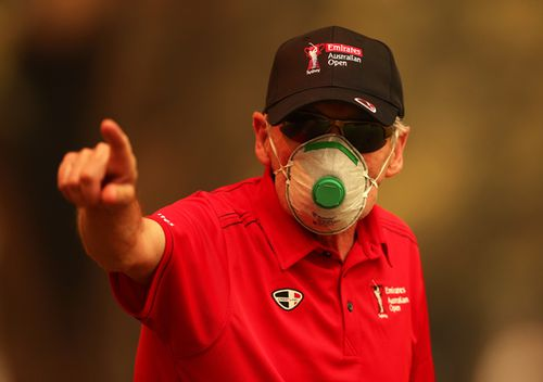 A course worker wears a face mask due to the smokey conditions during the 2019 Australian Golf Open.
