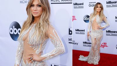 Jennifer Lopez bared some skin in a figure-hugging gown. (AAP)
