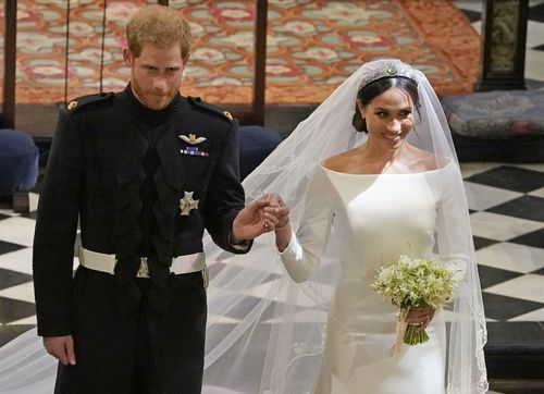 The married couple leave St George's Chapel after the ceremony. Picture: PA