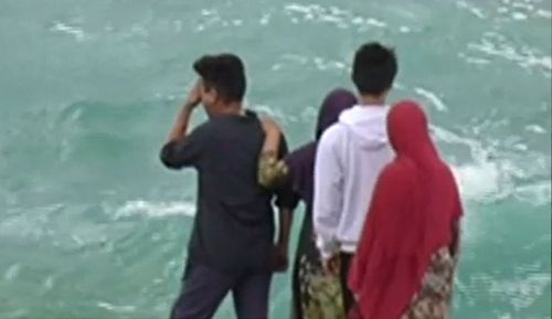 """Mr Yari's family watched the search from the shoreline, with his father vowing to stay """"until I get my missing son""""."""