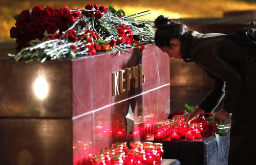Mourners were seen laying flowers at a monument to the city of Kerch.