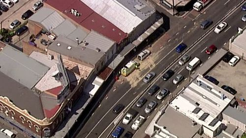 Fuel spills on major Sydney road after truck ruptures tank in median strip crash