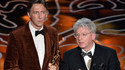 Filmmakers Nicholas Reed (L) and Malcolm Clarke accept the Best Documentary, Short, award for The Lady In Number 6.