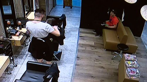 The 24-year-old Greenvale man sits in the salon, pretending to be a customer, before being pounced on by police. Picture: Supplied