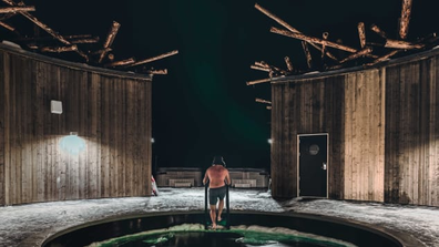 Man emerges from plunge pool at Arctic Bath hotel in Swedish Lapland