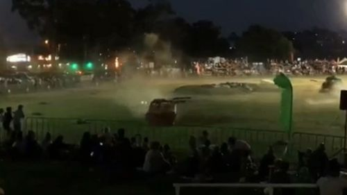 A family night out at a monster truck show in Brisbane has come to a shocking end after a stunt car smashed into a crowd of onlookers.