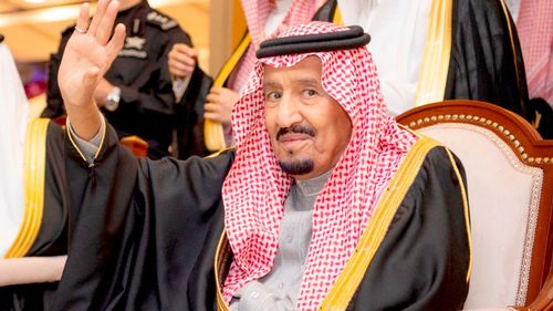 Saudi King Salman waves during his visit to Qassim province in Qassim, Saudi Arabia.