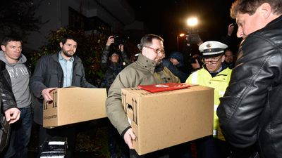 Investigators carry boxes of items from the family home of Andreas Lubitz. (AAP)