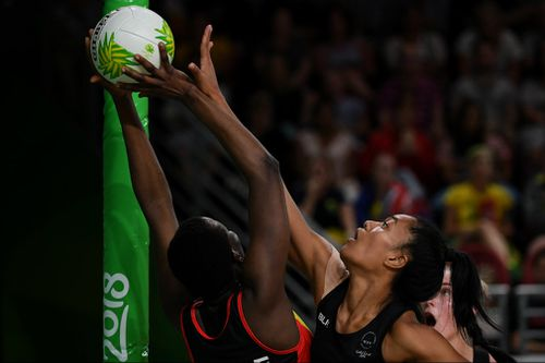Temalisi Fakahokotau of New Zealand tries to block a shot by Peace Proscovia of Uganda. (AAP)