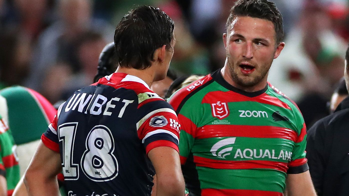 Sam Burgess of the Rabbitohs exchanges words with Billy Smith