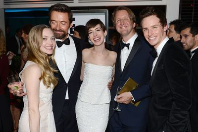 Amanda Seyfried, Hugh Jackman, Anne Hathaway, director Tom Hooper and Eddie Redmayne celebrate <i>Les Mis</i>' wins.<br/><br/>Image: Getty
