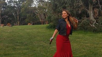 Mariah Carey has arrived on our Aussie shores and she's already hugged a koala, danced in a field of wild kangaroos and enjoyed dinner with a certain Australian act, Nathaniel. Check out her photo album...<br/>