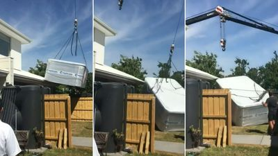 Moment crane crashes into home