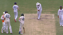 Rohit Sharma shadow bats as Steve Smith watches on.