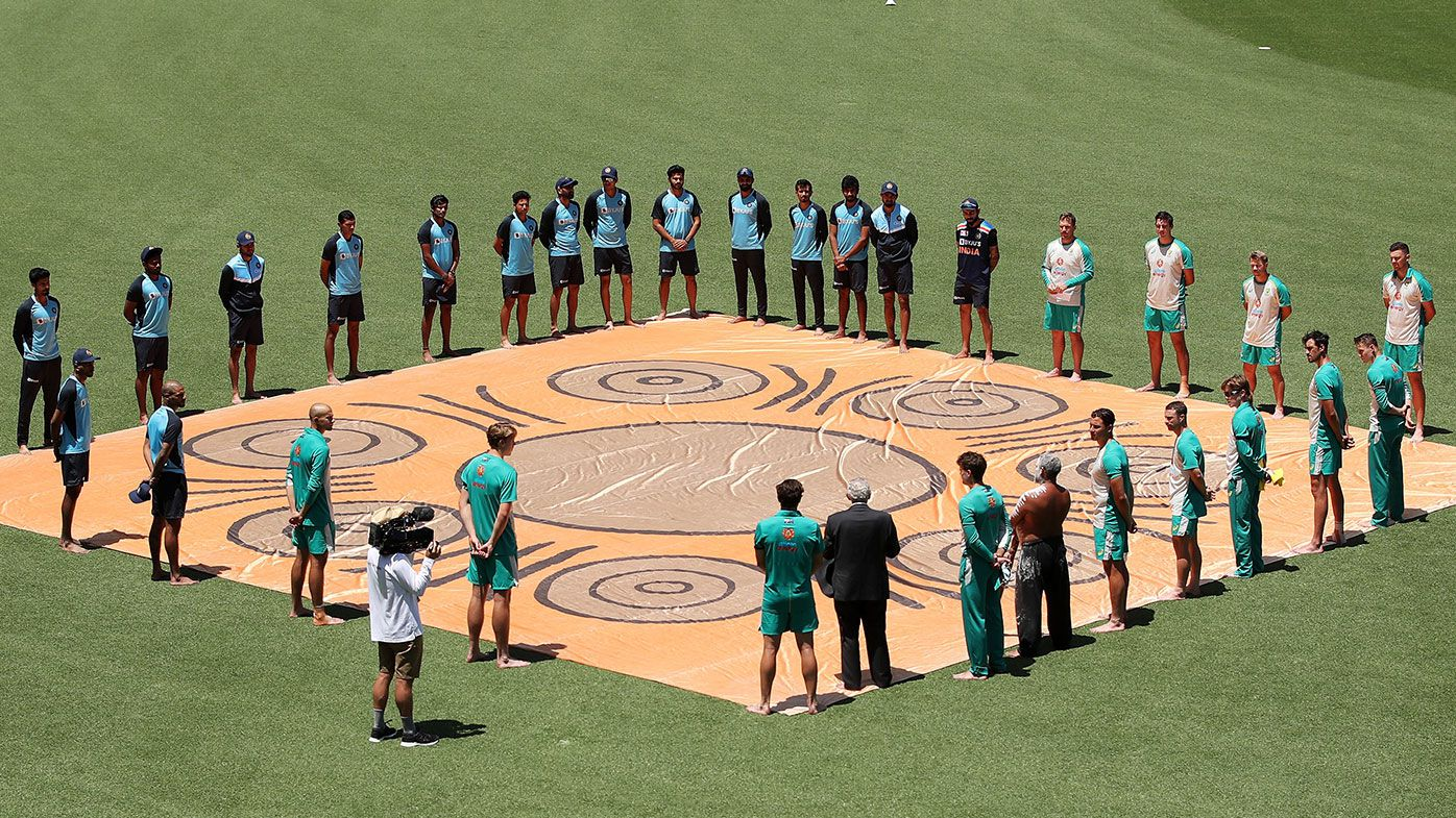 Australian and Indian players participate in a Barefoot Ceremony ahead of game one of the One Day International series between Australia and India at Sydney Cricket Ground