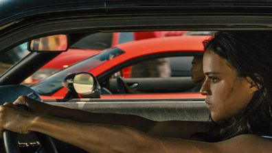Michelle Rodriguez in the movie Fast and the Furious in a car