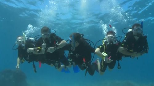 Coroner O'Connell has recommended instructors remain within arm's reach of divers, and link arms in poor conditions. Picture: 9NEWS