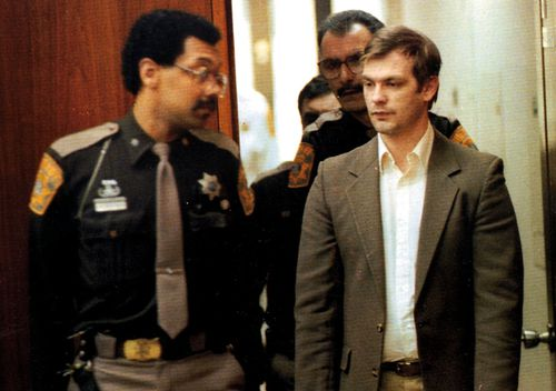 Serial killer Jeffrey Dahmer, right, is led into Milwaukee County Circuit Court in 1992. Dahmer admitted killing 17 young men and boys. He later was beaten to death by a fellow inmate in prison.