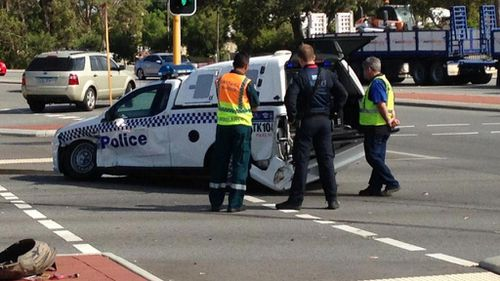 Police dog squad car T-boned at intersection in Perth
