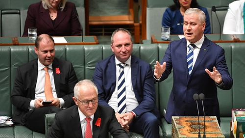 Prime Minister Malcolm Turnbull and then-Minister for Small Business Michael McCormack during Question Time in the House of Representatives at Parliament House in Canberra in October, 2017. (AAP)