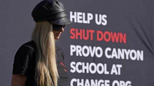 Paris Hilton speaks before leading a protest in Utah.