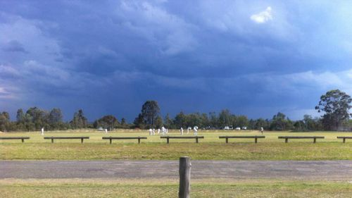 Storm clouds hang over a weekend cricket match at Cessnock in the Hunter. (Amber Huolohan)