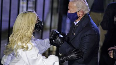 Democratic presidential candidate former Vice President Joe Biden talks with Lady Gaga during a drive-in rally at Heinz Field, Monday, Nov. 2, 2020, in Pittsburgh.