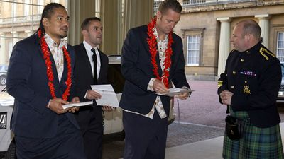 The Samoan contingent wore traditional clothing for the visit. (Getty)
