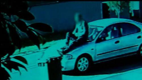 Video emerged of a man sitting on the bonnet of a vehicle while driving through an Adelaide street. Picture: Supplied