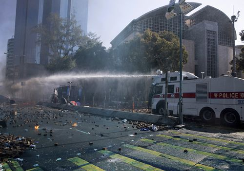 Water cannon trucks drove over bricks and nails strewn by protesters and sprayed them at close range in a bid to drive away protesters on the streets outside the Polytechnic.