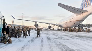 US Marines disembark after landing on January 16, 2017 in Stordal, Norway. Source: AFP