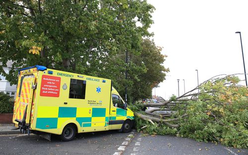 An ambulance which crashed into a fallen tree in Newcastle.