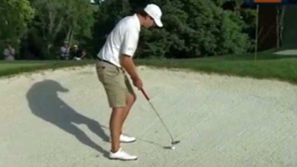Bunkered golfer forced to hit 'Texas Wedge'