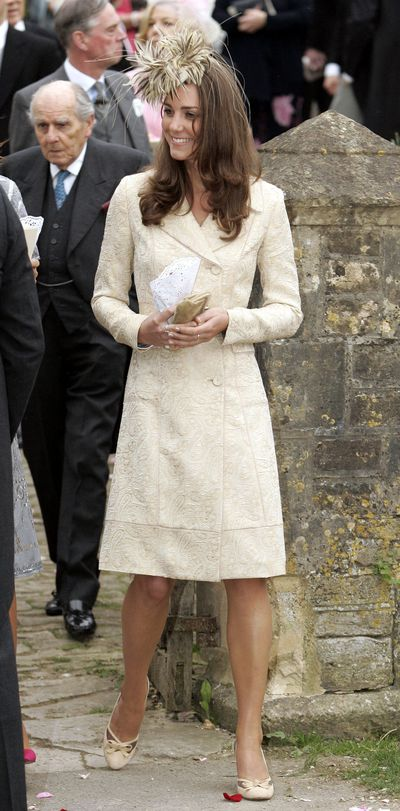 In May 2006, Kate attended the wedding of Laura Parker-Bowles and Harry Lopes.<br /> Laura is the step-sister of Prince William and Prince Harry.<br /> Kate looked chic in a DAY Birger et Mikkelsen brocade coat.