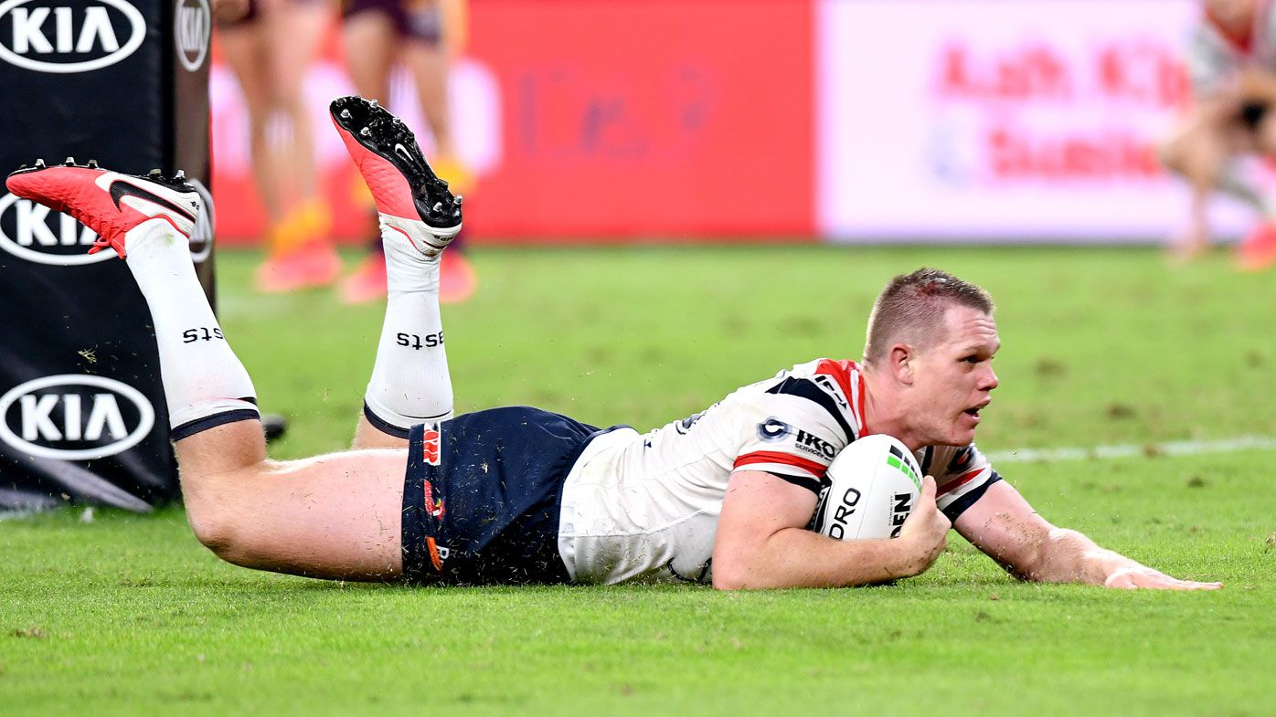 Lindsay Collins of the Roosters scores a try