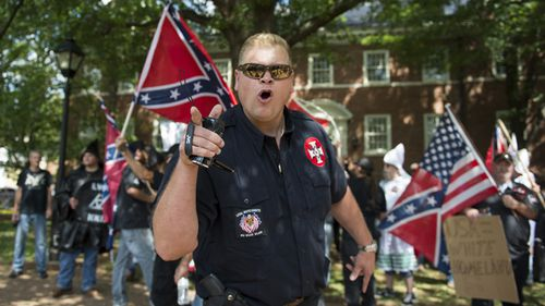 A member of the Ku Klux Klan shouts at counter protesters during a rally, calling for the protection of Southern Confederate monuments, in Charlottesville, Virginia.