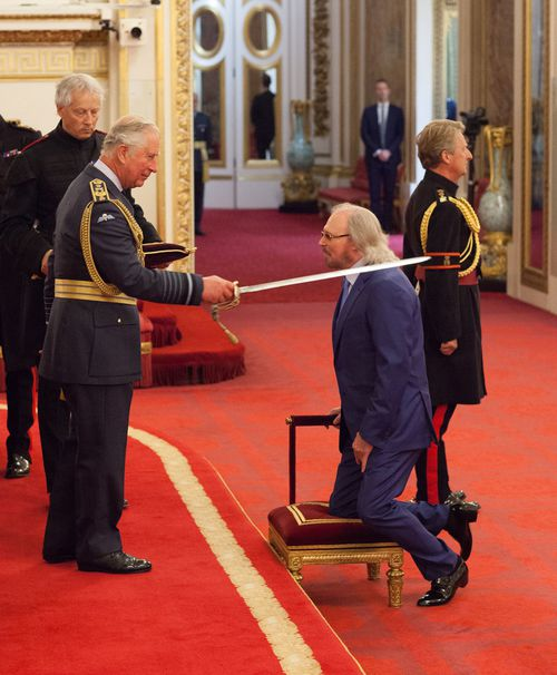 Bee Gee Barry Gibb has received a knighthood at Buckingham Palace, and says he hopes his late brothers Robin and Maurice are proud of him. Picture: PA