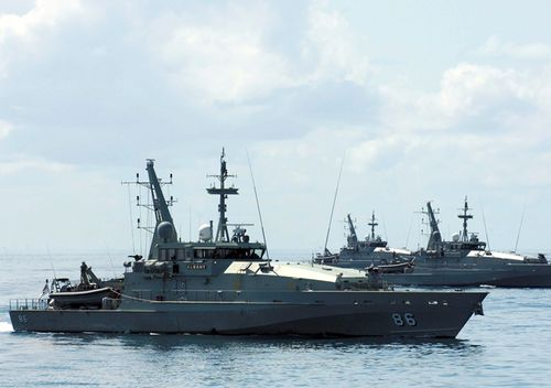 Armidale Class Patrol Boats near Ashmore Island off the coast of Western Australia. Two Armidale patrol boats are in the Philippines to train the navy how to intercept foreign fighters trying to enter Mindanao.