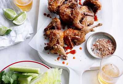 Fried quail with cucumber wedges