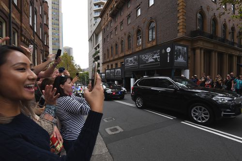 Crowds gathered to try to catch a glimpse of Obama as he arrived in a security motorcade (AAP)